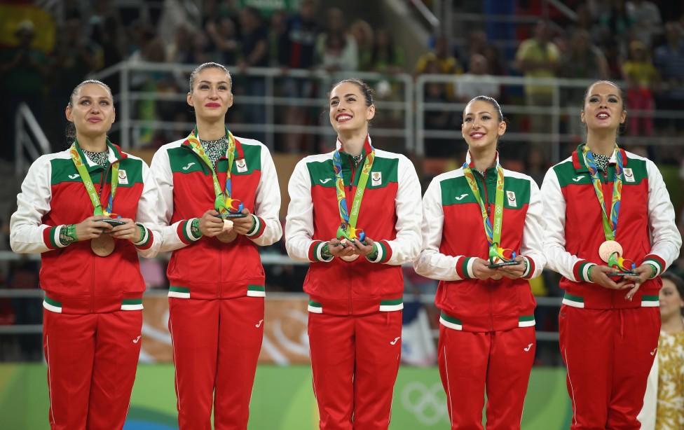 - Aнсамбълът по художествена гимнастика на България завоюва бронзовото отличие на Игрите в Рио.