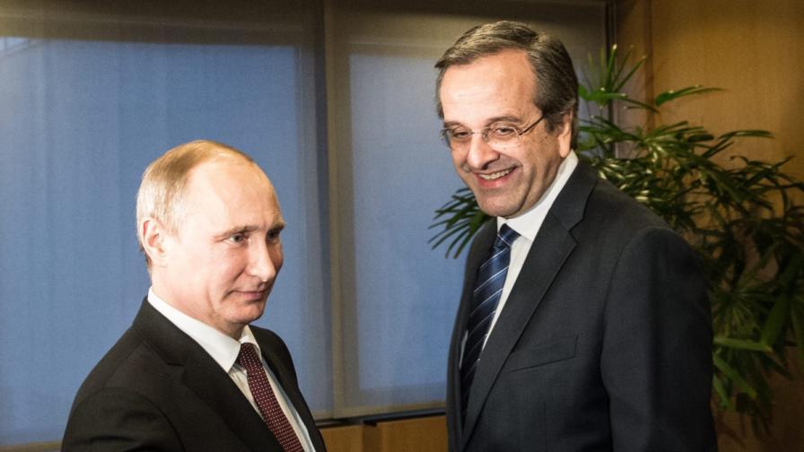 Владимир Путин (л) и Андонис Самарас