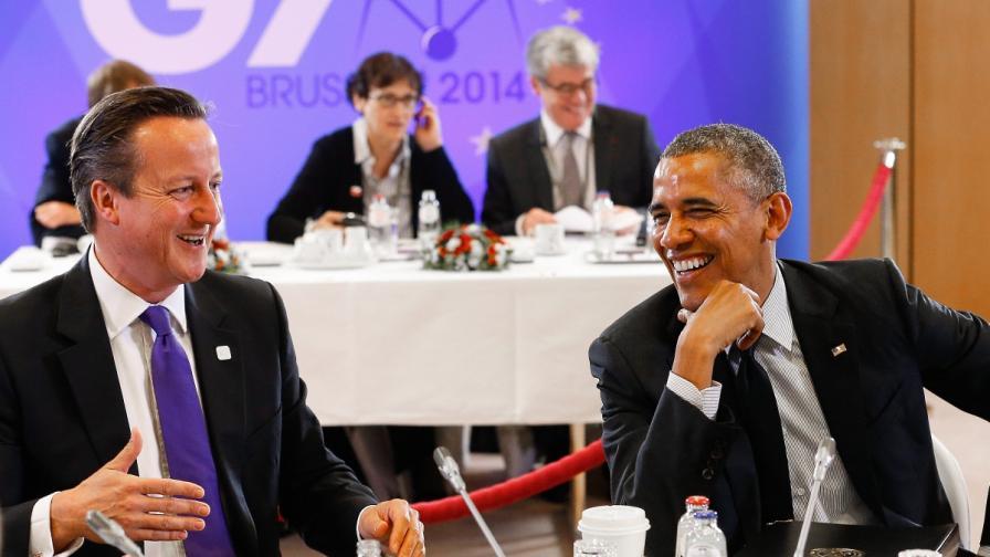 Обама (вдясно) и Камерън