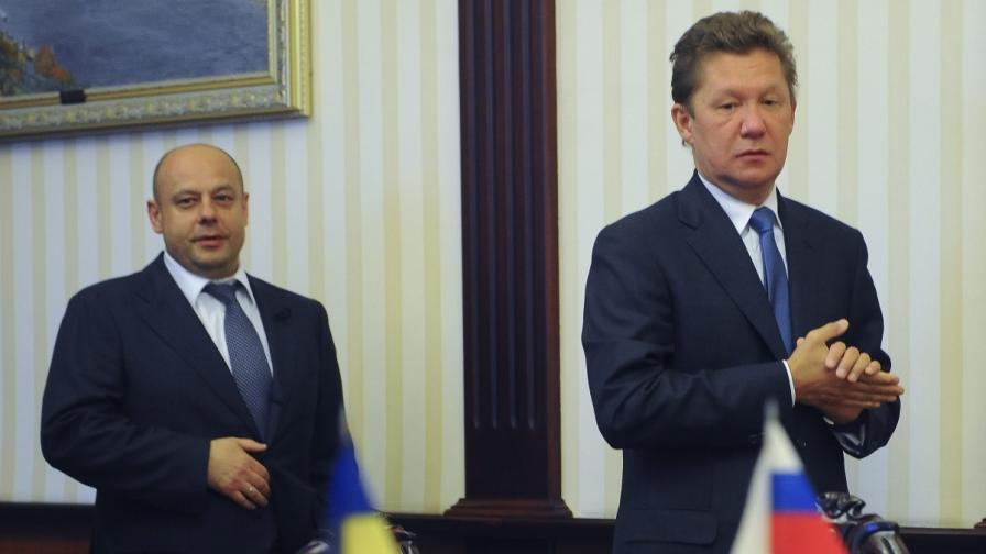 """Шефът на """"Газпром"""" Алексей Милер (д) и украинският министър на енергетиката Юрий Продан"""