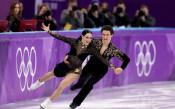 Канадска двойка поведе при танцовите двойки, французойка показа гръд