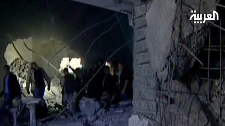 Кадър с разрушената къща
