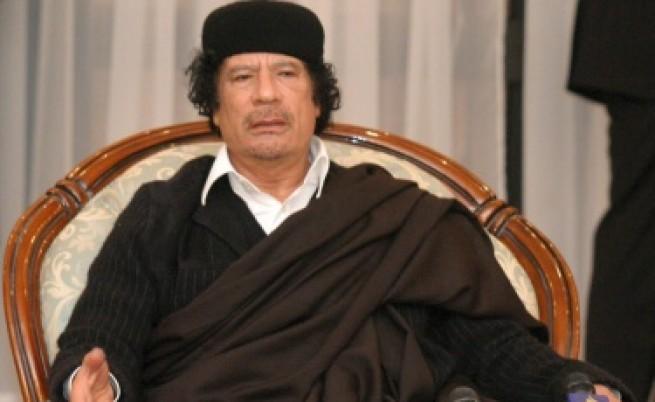 Муамар Кадафи -