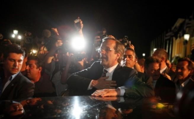Политици и финансисти резервирано приветстват резултата в Гърция