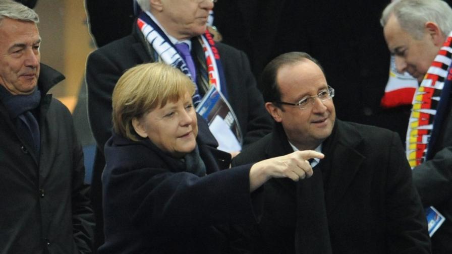 Оланд и Меркел заедно на мач